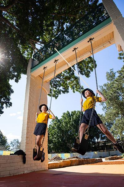 School students on swings at Simpson Park, St Peters