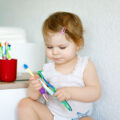 Child holding toothbrush
