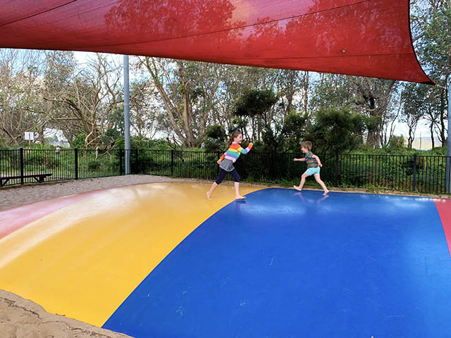 Kids on bouncy pillow - NRMA Ocean Beach Resort